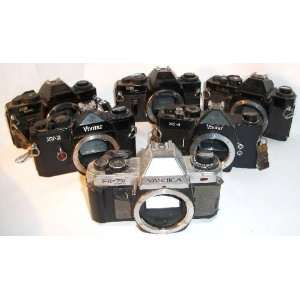 Large Lot of 6 35mm SLR Camera Bodies Everything Else