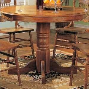 Mackinaw Round Pedestal Wood Dining Table in Medium Oak by