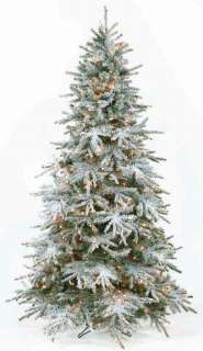 This artificial Christmas tree is slim and snow covered. The sparse