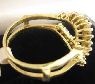 GOLD ENGAGEMENT DIAMOND RING ENHANCER. IT HAS 0.56 CTS. MARQUISE