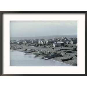 Fishing boats line the shore of Saint Pierre Framed Art